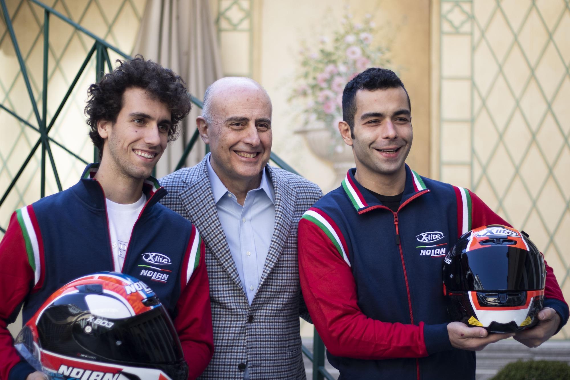 Petrucci e Rins con l'amministratore delegato di Nolan Group Panacci